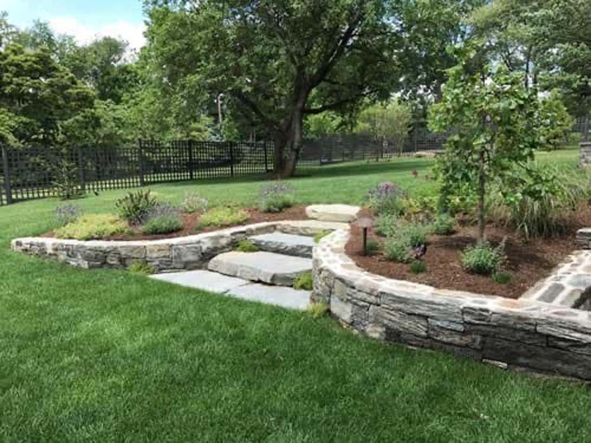 Custom Gray Flagstone Treadstone Steps and Shist Stone Walls