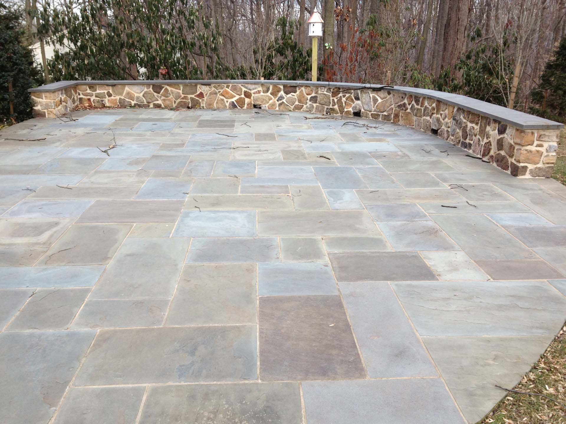 Flagstone Pointed Patio with Complimentary Masonry Fieldstone Pointed Wall and Flagstone Cap.