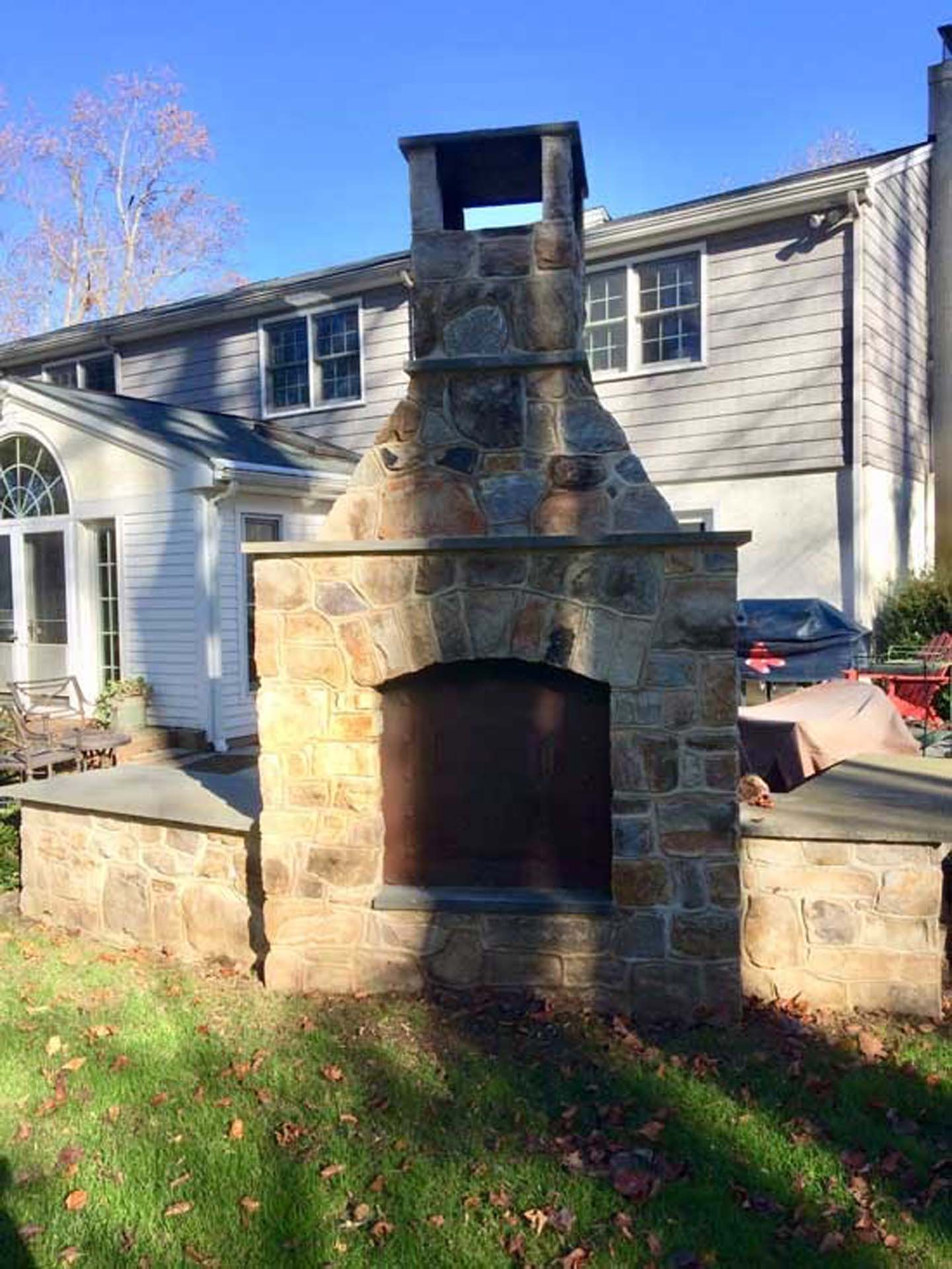 Outdoor Fireplace Back Opening with Flagstone Mantel Hearth and Sitting Walls with Flagstone Cap