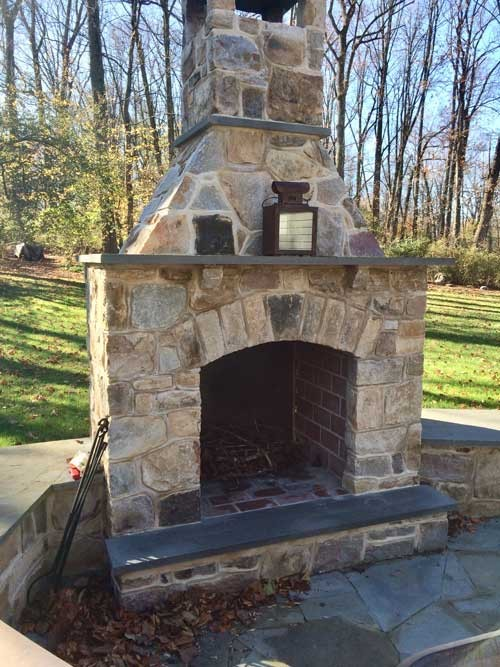 Outdoor Fireplace with Flagstone Mantel Hearth and Sitting Wall with Flagstone Cap